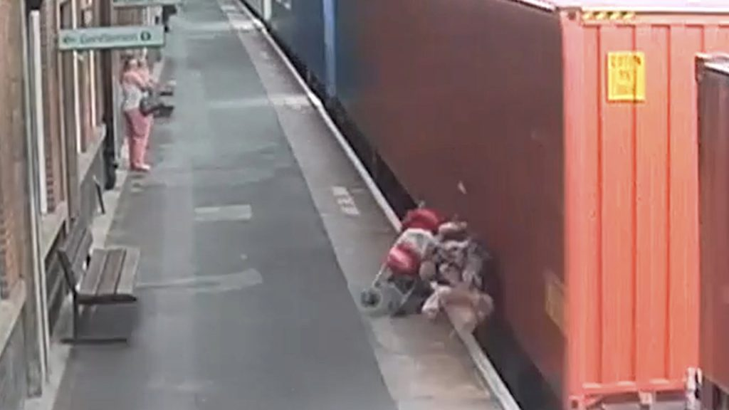 This is the shocking moment a child's buggy was ripped apart when it rolled across a railway platform and into the path of an oncoming train at Nuneaton Train Station, Warwickshire.