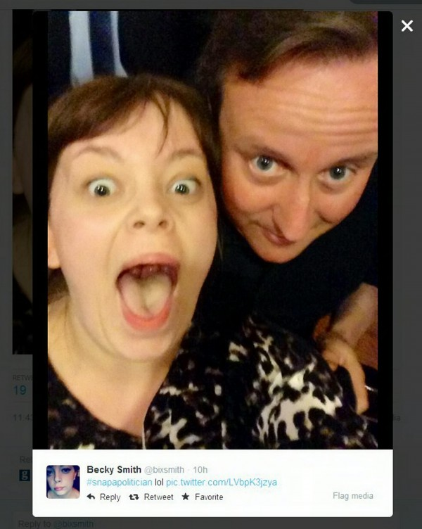 Student Becky Smith poses for a selfie with Prime Minister David Cameron as he stops at Nando's in Bristol for a meal