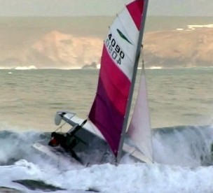 The moment that Captain Calamity Glenn Crawley capsized his catamaran for the 15th time