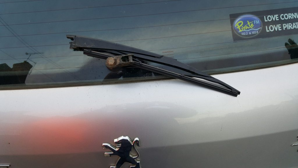 Damage to Anita Meek's car after it was attacked by  Christine Ann Potten.