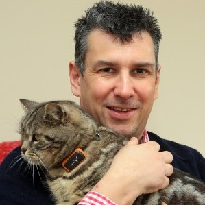 Dave Evans, 42, with 'Yollo' the cat, wearing a G-Paws GPS tracker