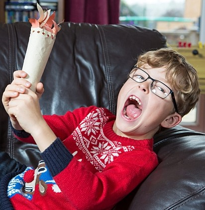 Logan McKerrow with his charity torch which has raised £34,000 though eBay relay auctions