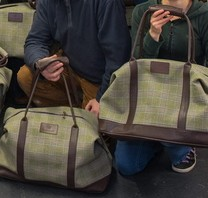 Staff at Owen Barry with some of the 350 suede bags they have produced for Prince Charles to give as Christmas gifts