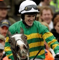 A.P. McCoy celebrates his victory in the Cheltenham Gold Cup in 2010