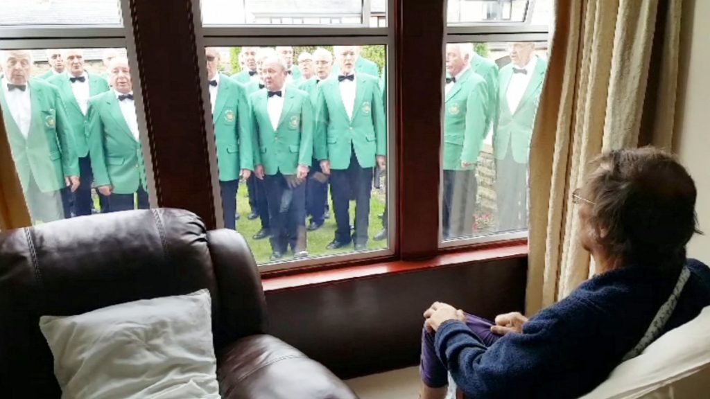 This is the moment a terminally ill singer was given a rousing send off by his beloved male voice choir who gathered outside his window to sing with him one last time.