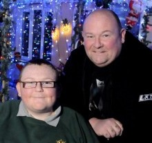John Baggott and his disabled son Shay with their Christmas lights display in 2012 which the council has this year banned on health and safety grounds