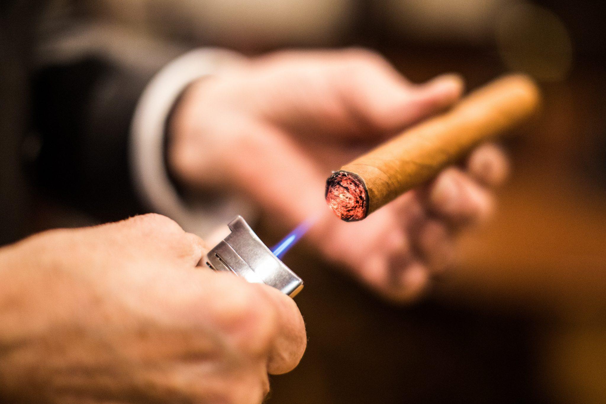 Smoking cigar with asshole big