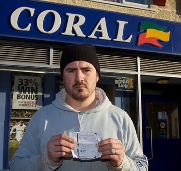 Chris Fear, 33, outside the Coral betting shop which is refusing to pay out on his 485/1 winning bet