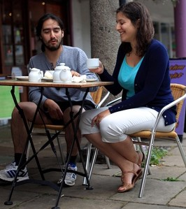 Maria Magou and Lambros Hadjimichael drinking coffee in Totnes, Devon