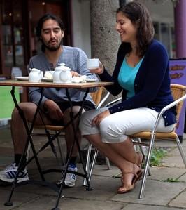 Maria Magou and Lambros Hadjimichael drinking coffee in Totnes, Devon