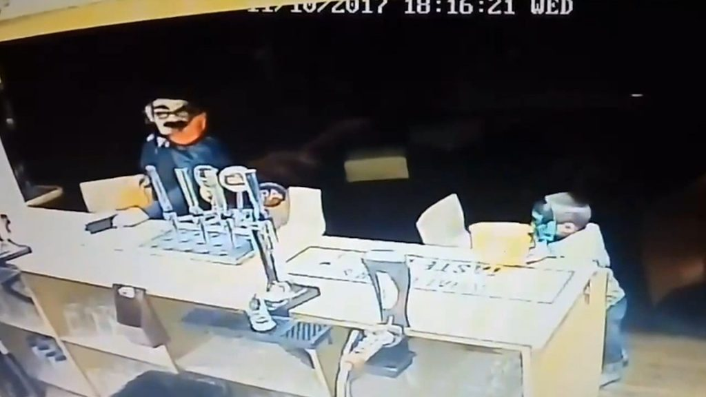 This is the astonishing moment a child stole a phone from a bar - while wearing a Halloween costume at The Lanterns snooker club in Folkestone, Kent.
