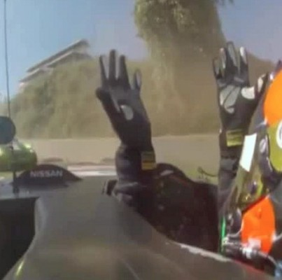 Gunnar Jeannette throws up his hands after losing control of the 'Batmobile'