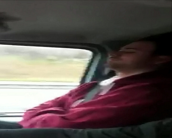 A van driver is filmed asleep at the wheel with his arms folded