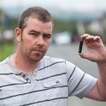 Christopher Thomas, 37, with the electronic cigarette that blew up and set fire to his car