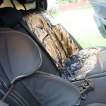 The fire damage on the seats of the car