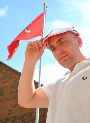 Adam Lawson with the England cap that got him sent home from work
