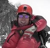 Extreme maths teacher Rob explaining equations on Moutn Everest