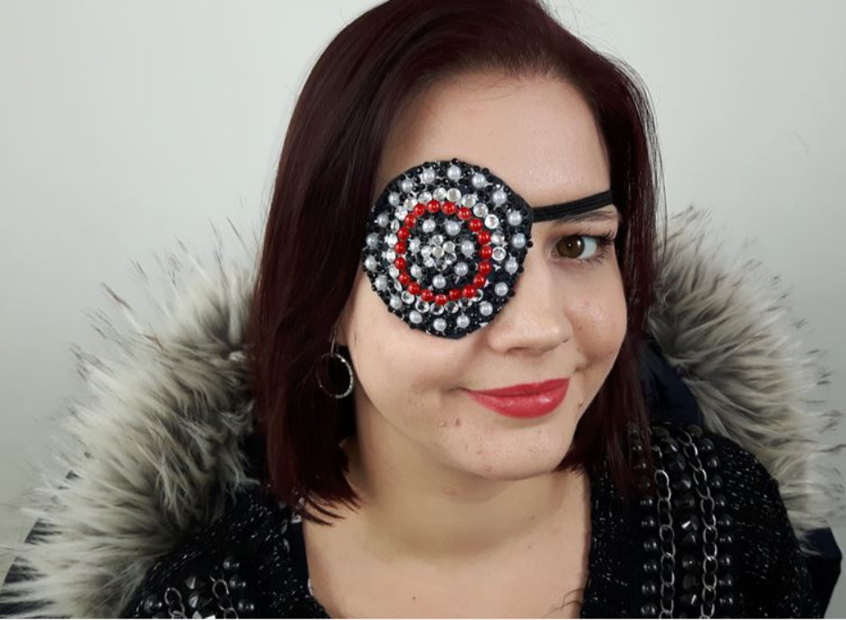 Mum who lost her eye to cancer makes custom eye-patches - covered in pirate-style jewels.