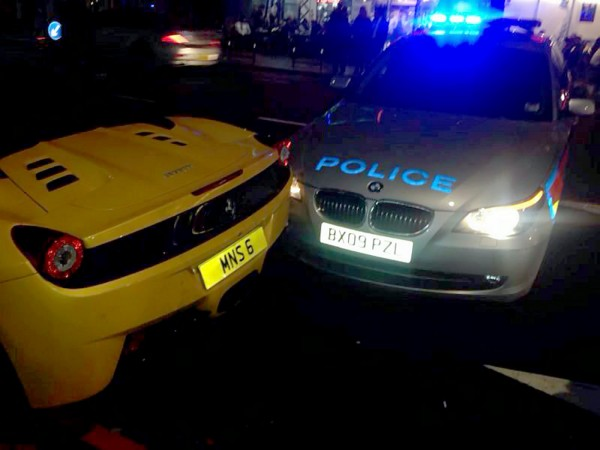 The moment a police car pulled a u-turn and ploughed into a Ferrari