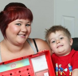 Sarah Boyen with her son Kyle and the toy work bench he had to be rescued from