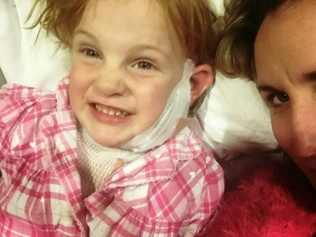 Stephanie Roe pictured in hospital as she recovers from being hit in the neck by a firework.