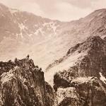This breath-taking photograph shows a climber on a narrow ridge