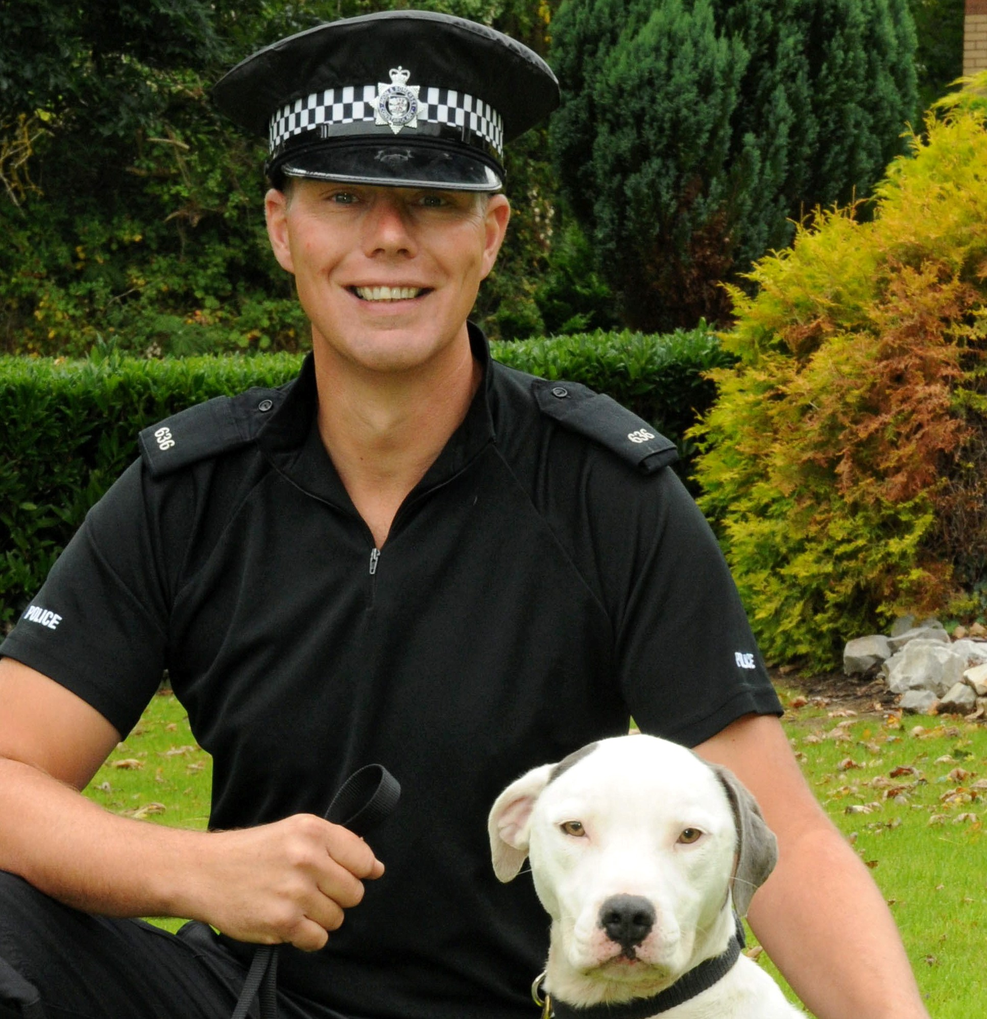 Dog handler PC Lee Webb with Kos the Staffie, the first Staffordshire Bull Terrier to work for a police force