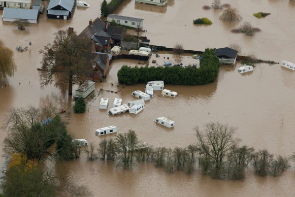 The floods that have hit Tewkesbury, Gloucestershire, where traffic wardens put parking tickets on cars stranded in the water