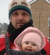 Mike Rodman, who collapsed and died during an amateur football match, holds his daughter in a picture taken just days before the tragedy