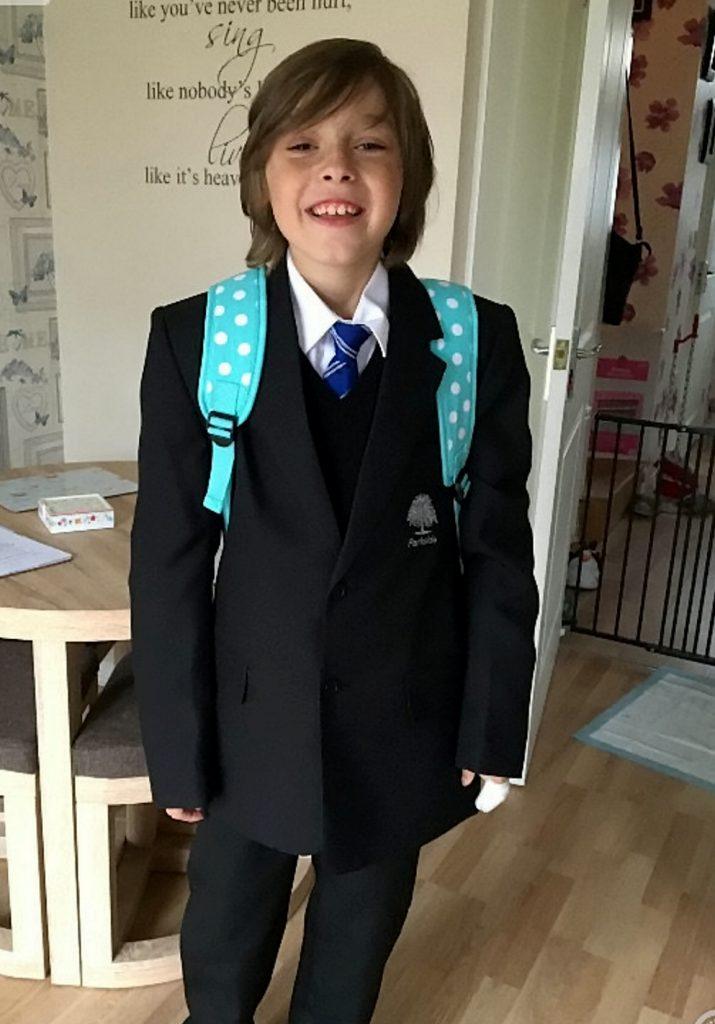 Kian in school trousers 2016.