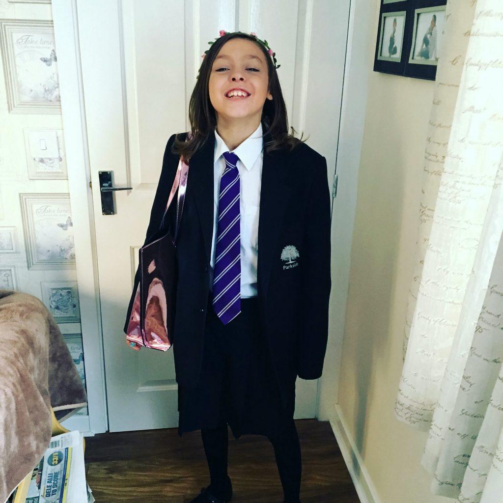 Zoey in school skirt.