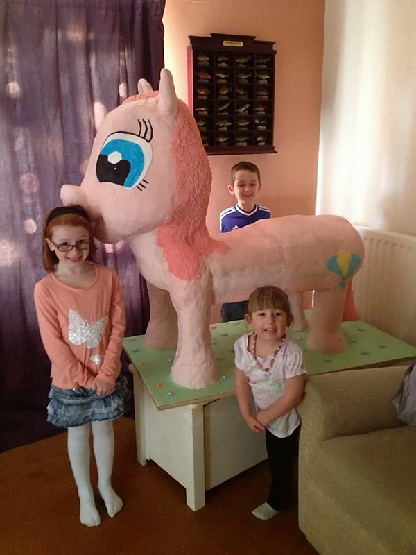 Maria's children, L-R Emily 8, Logan 9 and Brooke 3, with the pink pony cake
