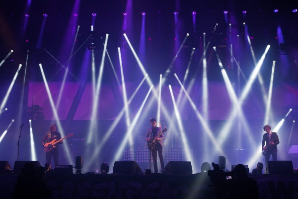 The Arctic Monkeys on stage at an earlier gig