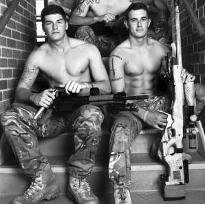Royal Marines with their guns for the charity calendar