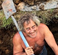 Ray standing in the grave with his shovel