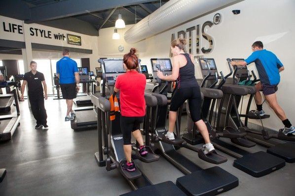 People exercise use the new 'ARTIS' machines supplied by Technogym at the club, Cadbury House, Somerset