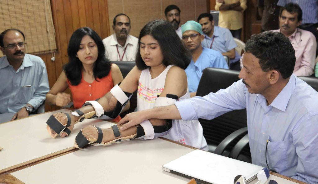 Hand transplant recipient Shreya with her parents and Dr. Subramani.