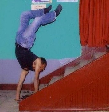 Tameru Zegeye walks up stairs on his hands after being born with deformed legs