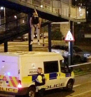 Lee Bassett, 29, hangs over the busy motorway in a harness