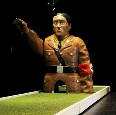 A controversial new exhibition mixing crazy golf and Adolf Hitler at the Arnolfini in Bristol has sparked outrage