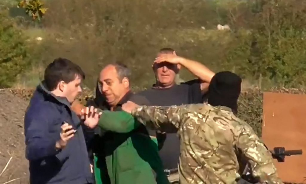 This is the shocking moment a farmer was caught on camera driving a quad bike at a group of fox hunt demonstrators.