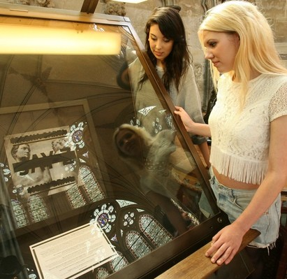 Laura Penny, 18, left, and Katie Freeman, 19, view the Jay Z album artwork 'Magna Carta' Holy Grail displayed in the Chapter House at Salisbury Cathedral