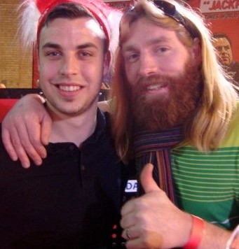 Jesus lookalike Nathan Grindal poses with a darts fan after discovering a new found fame