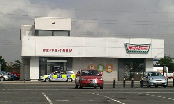 A police car in the queue outside Krispy Kreme doughnuts in Bristol. An onlooker said four other patrol cars were waiting