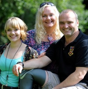 Royal Marine Lee Spencer with his wife Claire and children Billy and Harriet