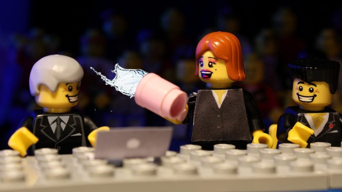 Sharon Osbourne throws water over Louis Walsh in one of the most memorable of X Factor moments. It is recreated in Lego