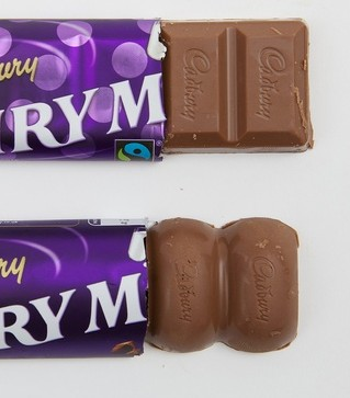 The old shaped Cadbury's Dairy Milk bar (top) and the new shape which is 4 grams lighter but still the same price
