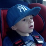 Levi Brailsford in the car seat from which he unbuckled himself and opened the car door.