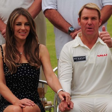 Liz Hurley and Shane Warne attend the Cricket for Kids charity event at Cirencester Cricket Ground
