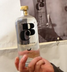 Jason Barber with a bottle of the world's first vodka made from milk
